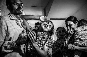 Murad's wife is screaming after his death. He left two children with his wife. He was attacked by political picketer during driving his own truck which was damaged also.Now his family have nothing without his memories.© Anik Rahman