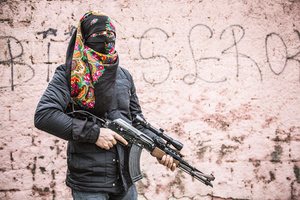 Deniz Bagok, a male guerilla fighter of the YPS, is posing in Kurdish-dominated city of Nusaybin in southeast Turkey, near the Syrian border. Heavy gunfights took place during several curfews between Turkish government special forces and Kurdish YPS guerilla fighters.