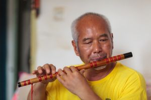 """Duan is described as a """"local legend"""" by friends and neighbours. He became blind at the age of 40 years after suffering glaucoma. He said """"I felt bad because I could not see. I felt troubled because I was unable to do simple tasks"""". As a result of various therapeutic services, Duan now walks with a cane and has a cleaning job at a local college, where his daughter works as a teacher."""