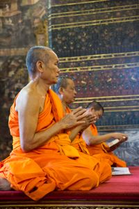 Bhikkhus (Buddhist monks) praying  in a temple in Thailand