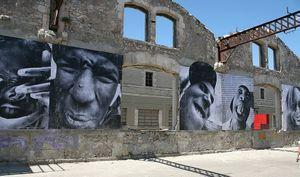 Installation view of JRââ?¬â?¢s work shown in Arles, France, 2007. © jr