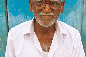 Curiosity, this old man observing me through his thick lensed glasses.