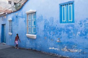 Blue alley and woman, Santiago de Cuba.