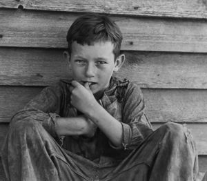 """Floyd Burroughs Jr., son of Floyd. Photo from """"Let Us Now Praise Famous Men."""" © Walker Evans. Published by Houghton Mifflin Company"""