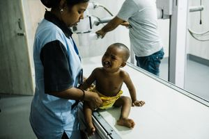 Amina is about to be x-rayed before her lip surgery. Calcutta, West Bengal, India. May 31st 2019
