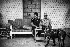 "Pedro Fumero & Pépé Agustin Matos Viera with their dog ""Terrible"""