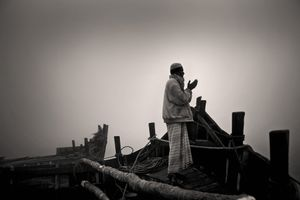 Aged 65, Aiyub Ali rises early to offer his prayers before a full day loading the boat with golpata. Sunderban, Satkhira. © Munem Wasif/VU'
