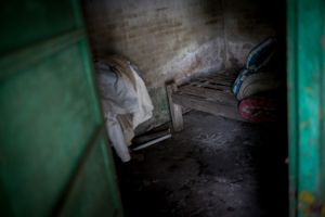 Indonesia, North-Bali,  18. April 2013 - A moldy dark shack was the home of a the mentally ill Wayan Budiawayan who were chained for 18 years to this bed. © Christian Werner