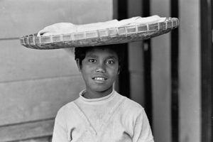 Young bread seller, Ruteng, 1973