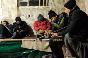 Refugees resting in a tent