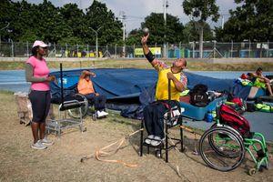 Joe Gonzalez Bettencourt, 38, throws a weight ball during a practice at Atanasio Girardot Stadium, Medellin, March 2016.