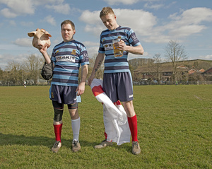 Tom Breakell and Craig Dixan from Shrewsbury RUFC with mascot 'Babe'.  Crediton Rugby Club match