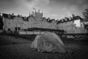 The first tent is erected in the shadow of the first house to be built in Bournemouth, which is now a hotel.