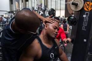 Physiotherapist Jorge Ortiz helps Fabio Torres, 39, stretch during a training session of power-lifting in High Performance Center, Bogotá, June 2016.