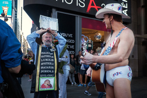 The success of the naked coxboy, who is one of the best known street performers at Times square, attracted many imitators. The performers claim that they have the right to dress how they want and to accept tipps, citing free-speech concerns for their performances in public spaces.