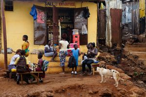 A shop in front of Angola town - a growing community made of illegally built tin houses.