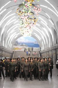 Female soldiers in the subway of Pyongyang.