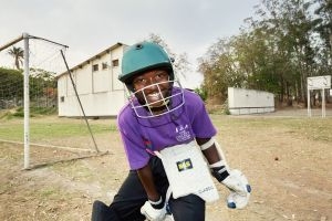 Vanessa gets ready to enter the batting cage. Malawian Under 19 Women's Cricket Team, Blantyre, Malawi, 2016.