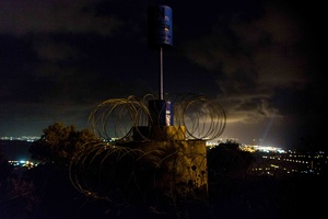 Blue Pillar, symbol-object that marks the boundary line. Israeli border in the background.