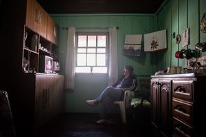 7 - Maria watching a television show in the kitchen