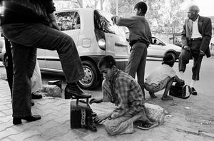 Sagar,9,and Pooja,8, shoe polishers,Delli Haat.