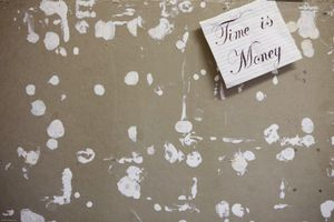 Time is money. All that is left on the prisoners notice board. Prisoners use toothpaste to stick items to the notice board as bluetack or pins are not allowed. Young Offenders Institution, Ayelsbury, United Kingdom.