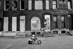 Baltimore, MD-A young child testing his electric motorcycle during the days of protest.