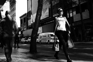 Woman strutting into the spotlight along Willis Street (New Zealand)