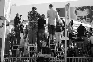 Photographers and members of the public spend much of the day on top of ladders placed across the road from the Palais des Festivals. From these perches they film and photograph stars on the red carpet. 2014  © Alison McCauley