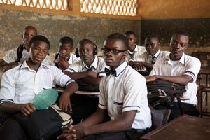Junior (17), sitting on the rite, is a former street boy and juvenile prisoner. Here he is with his class mates, waiting for the lecture to start.
