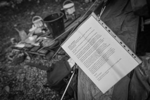 A notice of occupation hangs on a residents tent.